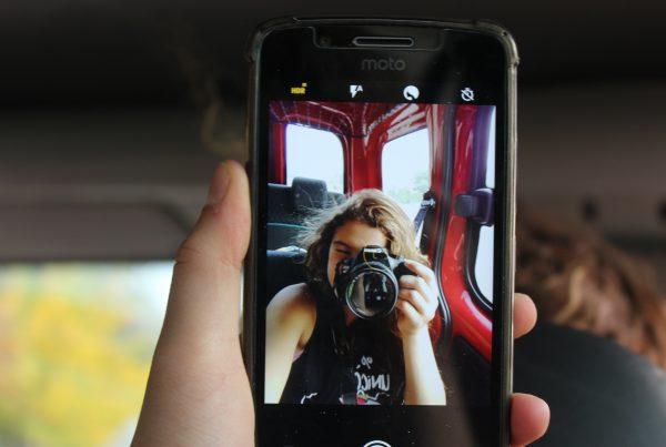 woman using camera photo