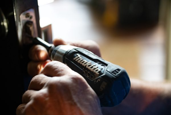 selective focus photography blue and black Makita power drill